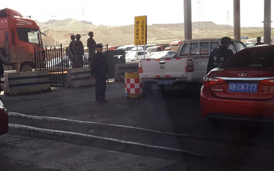 Armed guards at toll gate… Xinjiang